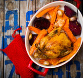 The chicken baked with root crops. Royalty Free Stock Image
