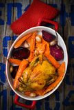 The chicken baked with root crops. Stock Images