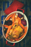 The chicken baked with root crops. Stock Photo