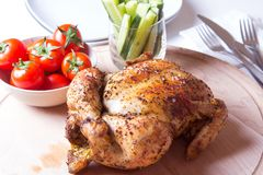 Chicken baked on salt. Selective focus, close-up Stock Images