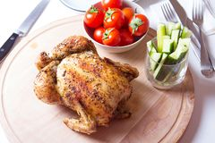 Chicken baked on salt. Selective focus, close-up Royalty Free Stock Photos