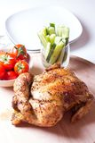 Chicken baked on salt. Selective focus, close-up Stock Image