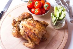 Chicken baked on salt. Selective focus, close-up Royalty Free Stock Photography