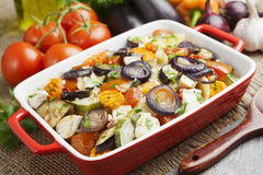 Chicken baked with vegetables. Chicken fillet baked with vegetables on the table stock photos