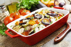 Chicken baked with vegetables. Chicken fillet baked with vegetables on the table royalty free stock photography