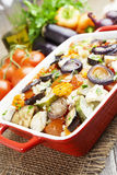 Chicken baked with vegetables. Chicken fillet baked with vegetables on the table royalty free stock photos