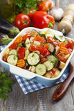 Chicken baked with vegetables. Grilled chicken with vegetables on the table royalty free stock image