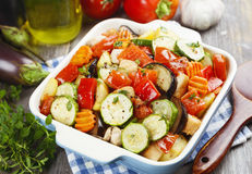 Chicken baked with vegetables. Grilled chicken with vegetables on the table stock images