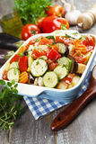 Chicken baked with vegetables. Grilled chicken with vegetables on the table royalty free stock photo