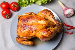 Chicken baked whole. Selective focus, close-up royalty free stock image