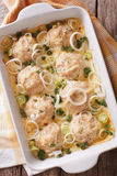 Chicken balls baked with cheese sauce closeup. vertical top view Royalty Free Stock Photos