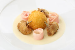 Chicken Balls -  breaded, deep fried balls filled with egg and Chickens legs served bacon, celery puree on white plate Stock Photo
