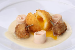 Chicken Balls -  breaded, deep fried balls filled with egg and Chickens legs served bacon, celery puree on white plate Stock Images