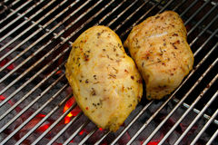 Chicken on the barbecue. Cooking tastetful meat on a barbecue outside in the garden Stock Images