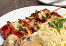 Chicken barbecue with spaghetti Royalty Free Stock Photography