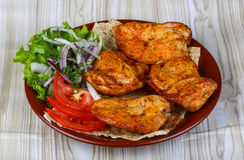 Chicken barbeque. Fresh hot Chicken barbeque with onion, herbs and tomato stock photos