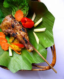 Chicken BBQ. Barbeque chicken leg served on a banana leaf Stock Photography