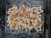 Chicken on BBQ with other ingredients. Royalty Free Stock Images