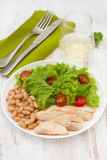 Chicken with beans, lettuce and tomato Royalty Free Stock Photography