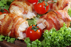 Chicken beaters in bacon submitted on leaves of salad with fresh Stock Image
