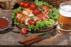 Chicken beaters in bacon submitted on leaves of salad with fresh Stock Photography