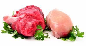 Chicken and beef. With parsley leaves surrounded by white background Royalty Free Stock Photo
