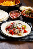 Chicken and Beef Fajitas with Vegetables and Tortillas Royalty Free Stock Photography