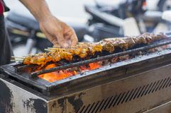 Chicken and Beef Satay. Cooking on a hot charcoal grill Royalty Free Stock Photos