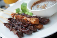 Chicken and beef skewers. With satay sauce Royalty Free Stock Photography