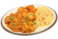 Chicken Bengal Indian Curry. Chicken Bengal with Bombay aloo potato curry and pilay rice Stock Photos