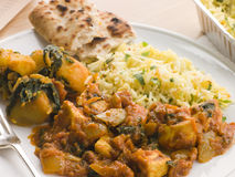 Chicken Bhoona, Sag Aloo And Pilau Rice Stock Photo