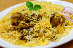 Chicken Biryani. Biryani, biriani, or beriani is a set of rice-based foods made with spices, rice (usually basmati) and meat, fish, eggs or vegetables royalty free stock image