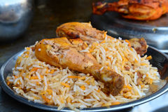Chicken Biryani. Biryani, biriani, or beriani is a set of rice-based foods made with spices, rice (usually basmati) and meat, fish, eggs or vegetables royalty free stock photo