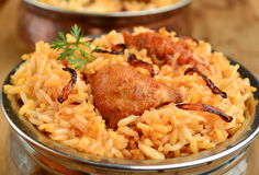 Chicken Biryani. Biryani, biriani, or beriani is a set of rice-based foods made with spices, rice (usually basmati) and meat, fish, eggs or vegetables royalty free stock photos