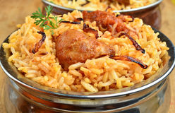 Chicken Biryani. Biryani, biriani, or beriani is a set of rice-based foods made with spices, rice (usually basmati) and meat, fish, eggs or vegetables stock image
