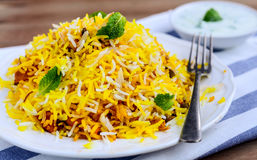 Chicken Biryani. Biryani, biriani, or beriani is a set of rice-based foods made with spices, rice (usually basmati) and meat, fish, eggs or vegetables stock photography