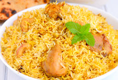Chicken Biryani. Biryani, biriani, or beriani is a set of rice-based foods made with spices, rice usually basmati and meat, fish, eggs or vegetables Royalty Free Stock Images