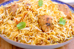 Chicken Biryani. Biryani, biriani, or beriani is a set of rice-based foods made with spices, rice usually basmati and meat, fish, eggs or vegetables stock images