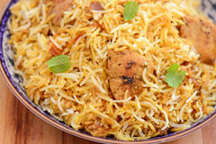 Chicken Biryani. Biryani, biriani, or beriani is a set of rice-based foods made with spices, rice usually basmati and meat, fish, eggs or vegetables royalty free stock image