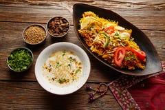 Chicken Biryani indian recipe with white soup Stock Photo