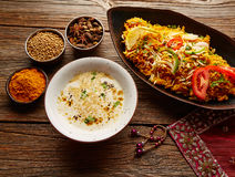 Chicken Biryani indian recipe with white soup Stock Photography