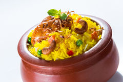 Chicken Biryani. Indian spicy chicken biryani served in clay pot Royalty Free Stock Photography