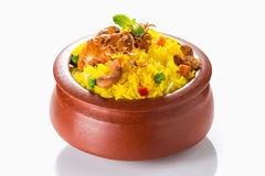 Chicken Biryani. Indian spicy chicken biryani served in clay pot Royalty Free Stock Image