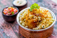 Chicken Biryani. Indian spicy chicken biryani served with raitha and tomato salsa stock photography