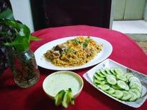 Chicken biryani with salad n raita stock photos