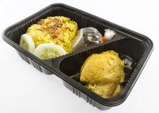 Chicken biryani with yellow rice in packing box Stock Image