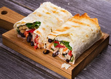 Chicken, Black Beans, Spinach and Tomato Burritos. Stock Image
