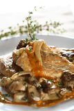 Chicken with boletus and herbs Stock Photo