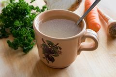 Free Chicken Bone Broth In A Mug With Vegetables In The Background Royalty Free Stock Photography - 108916207