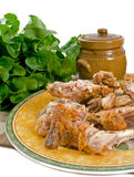 Chicken Bones After Meal. Left over chicken bones from fried chicken meal royalty free stock images